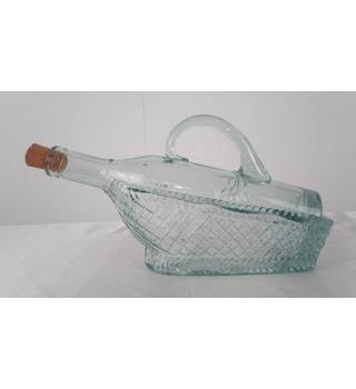 Bottle in a basket-shaped decanter